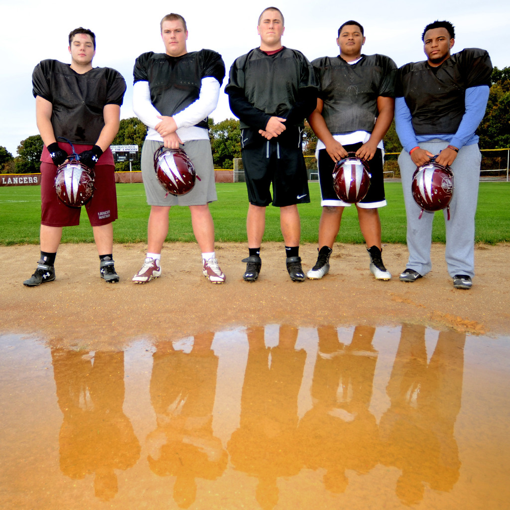 The dedication of Holy Cross offensive linemen (from left) Gary Whelan, James Chattin, Tim Wagner, Raphael Jackson, and Jalen Singleton has paid off for the Lancers this season. The seniors bring experience and size to the trenches.     TOM GRALISH / Staff Photographer