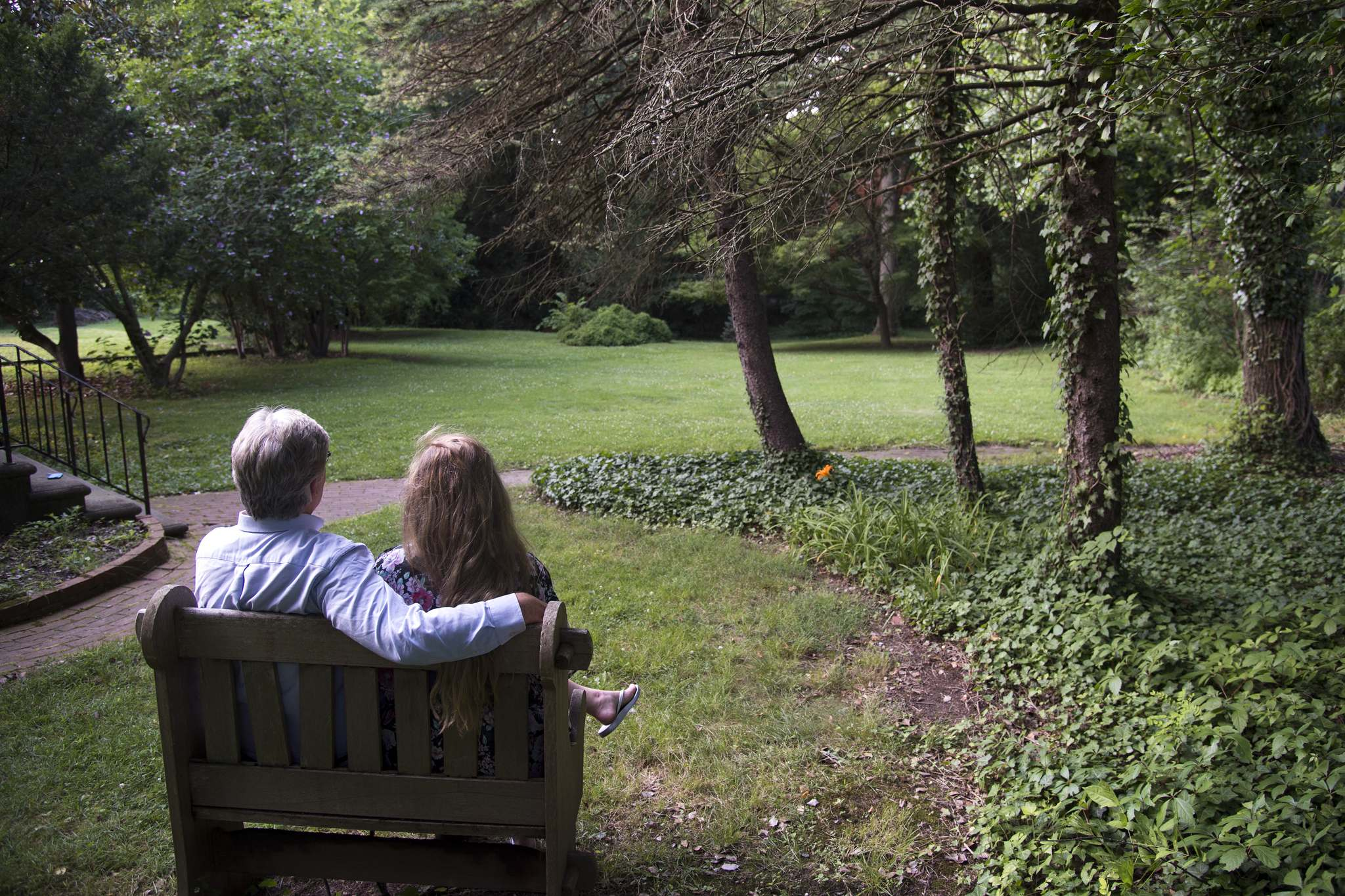 Matthew Doherty and his daughter Allison, 20, sit looking into the woods outside the cottage he rents, just behind Boxwood Hall, which is owned by The borough of Haddonfield, and is on the immediate site of a proposed arts center.