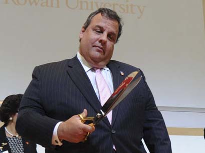 Gov. Christie taking a look at a ceremonial pair of scissors at the grand opening of the Cooper Medical School at Rowan University last week. ( CLEM MURRAY / Staff Photographer )