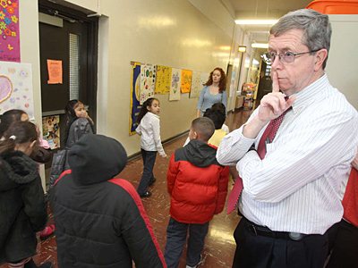 Principal James Otto gestures for students to proceed quietly to lunch at Sheppard Elementary. (CHARLES FOX / Staff Photographer)