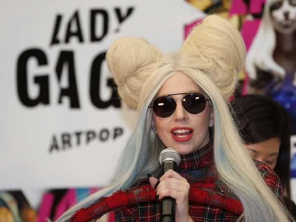 "Lady Gaga speaks during a press conference to promote her album ""ARTPOP"" in Tokyo, Sunday, Dec. 1, 2013. (AP Photo/Shizuo Kambayashi)"