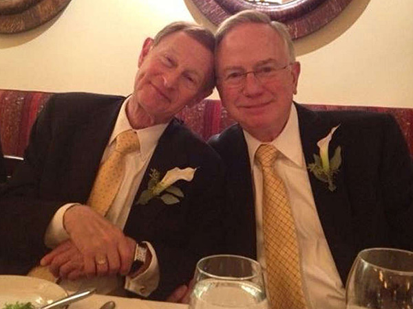 Joel Wind (left) and Alfred Munzer relax at their wedding luncheon. (David Lee Preston/Daily News Staff)