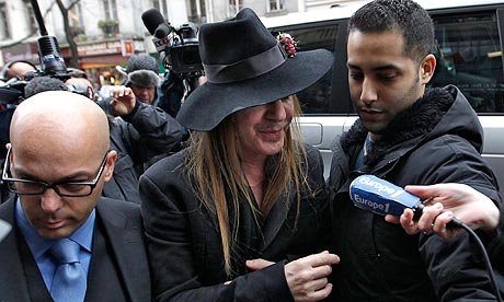John Galliano outside a Paris police station. He said on Wednesday he had co-operated with police in their investigation. Photograph: Ian Langsdon/EPA<br />