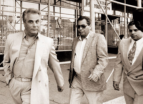 John Gotti (left) leaves Queens Criminal Court with his son John Jr. (2nd right), who was acquitted of assaulting a cop.