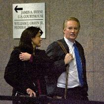 Larry Mendte and his wife, Dawn Stensland, after his sentencing. (John Costello)