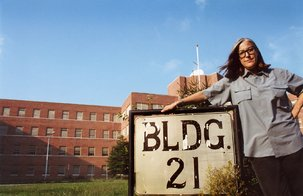 Filmmaker Lucy Winer in front of Building 21 at Kings Park State Hospital, where she had been institutionalized in 1967.