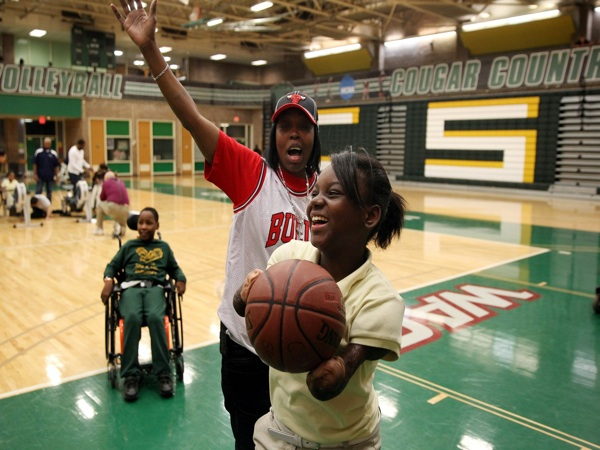 Ashanti Norals, foreground, plays basketball with LaKenya Corbin during their adaptive physical education class at Chicago State University, Nov. 19, 2013 in Chicago. (Adam Wolffbrandt/Chicago Tribune/MCT)