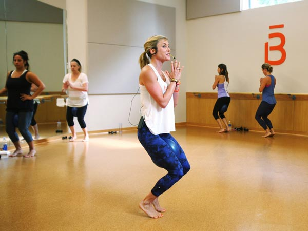 Barre3 teacher Tori Fox, left, leads the class in a workout Wednesday, July 8, 2014 at the studio´s Five Points location in Raleigh, N.C. A barre workout combines elements of balley, Pilates, and yoga. (Juli Leonard/Raleigh News & Observer/MCT)