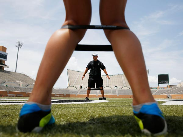 Strength coach David Trevino gives instruction during strengthening and conditioning exercises for the University of North Texas women´s soccer team in Apogee Stadium in Denton, Texas, Tuesday, July 8, 2014. (Andy Jacobsohn/The Dallas Morning News/MCT)