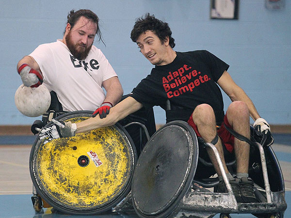 The Akron Rhinos´ Tom Wiersma, left, has the ball knocked away by Stephen Zurabel during a quad rugby team practice at Weaver Learning Center in Tallmadge, Ohio, on January 17, 2014. (Phil Masturzo/Akron Beacon Journal/MCT)