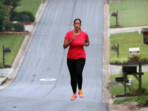 Bianca Cooper runs in Marietta, Ga., neighborhood, June 18, 2014. Cooper can run again, something she used to enjoy a lot in her Marietta subdivision before her stroke last year at age 29. Statistics show stroke is increasingly occurring among younger people. (Bob Andres/Atlanta Journal-Constitution/MCT)