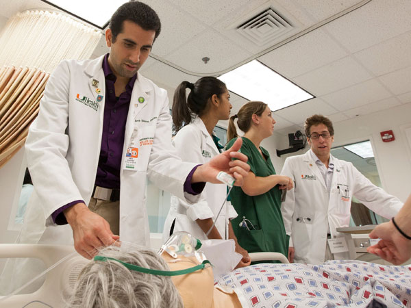 Medical student Amir Sharim, left, works on a high-tech mannequin at the University of Miami/Jackson Memorial Hospital Center for Patient Safety. (University of Miami/Miami Herald/MCT)