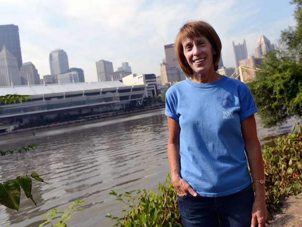 Tami Rippy, event organizer of the Violet Rippy 5K Run/Walk for Pulmonary fibrosis -- in honor of her mother -- along the event route along Pittsburgh´s North Shore Trail on August 1, 2014. (Pam Panchak/Pittsburgh Post-Gazette/MCT)