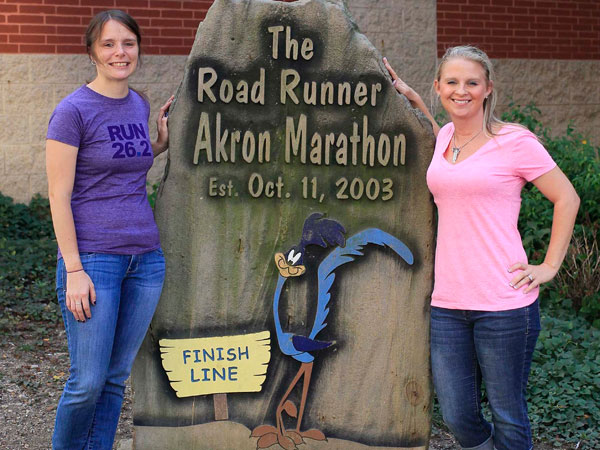 Lynne Trenkelbach, left, and Heather Pariso will run this year´s marathon in Akron, Ohio, on a relay with Tony Lindeman who the two revived last year after he suffered a heart attack during the race. (Karen Schiely/Akron Beacon Journal/MCT)