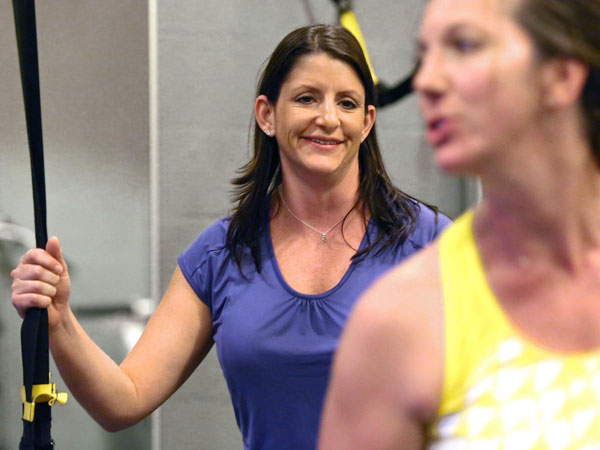Health coach Nicole Copare, left, smiles as she coaches Regina Camplin during a workout at TV Fitness Pros in Orlando, Fla., on Dec. 5, 2013. (Stephen M. Dowell/Orlando Sentinel/MCT)
