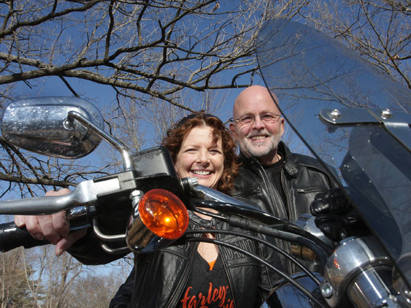 After surviving cancer, Patty Knox of Overland Park, Kan., bought herself a Harley Davidson Dyna low-rider trike and now makes more time to ride with her husband, Jerry. ( Susan Pfannmuller/Kansas City Star/MCT)