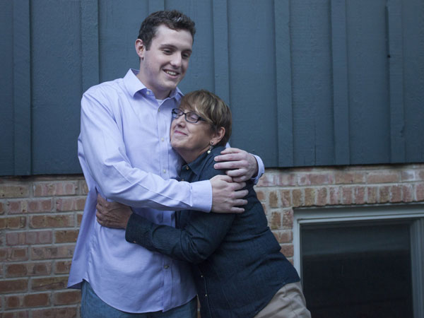 Joann Sullivan hugs her son Bryant Sullivan, 23, at their home on Aug. 14, 2014, in Barrington, Ill. Bryant, who´s mother received a life-saving stem cell transplant, will be a stem cell donor for a woman his mother´s age. (Armando L. Sanchez/Chicago Tribune/MCT)