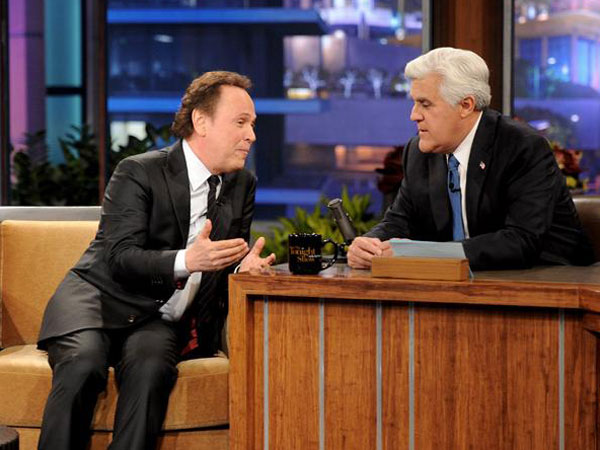 Jay Leno during his farewell show with Billy Crystal (left).