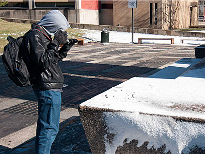 Abdullah Bamajboor, 18, a Saudi exchange student, takes his first photos of snow at Temple.
