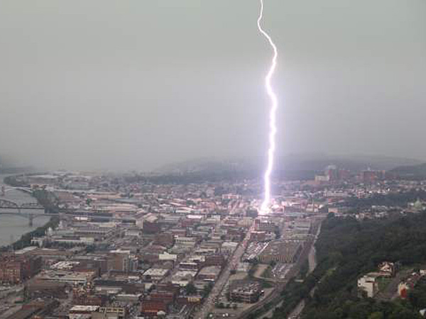 FILE PHOTO: Lightning touches down in the area around Lawrenceville, Pa., and the Strip district during an afternoon storm  on Tuesday, July 16, 2013. (AP)