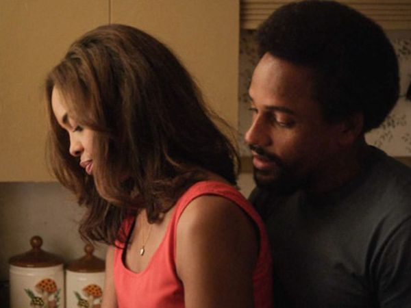 "Sharon Leal and Hill Harper in ""1982."""