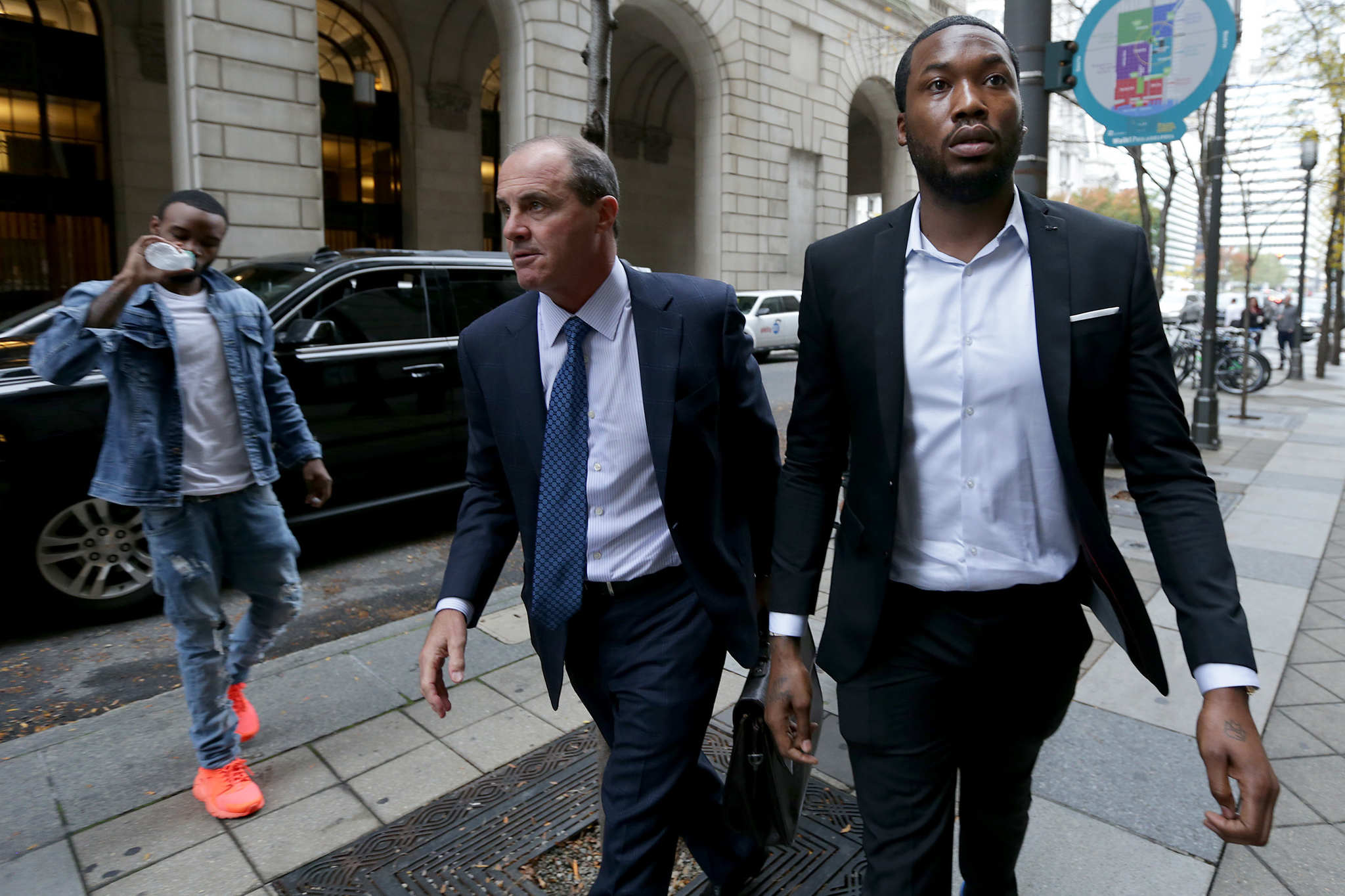 Rapper Meek Mill, right, arrives the Criminal Justice Center with his lawyer Brian McMonagle, center, in Philadelphia, PA on November 6, 2017.