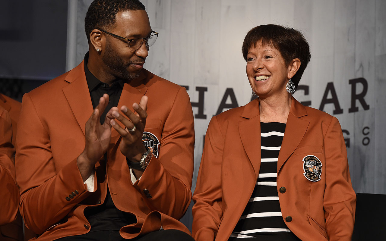 2017 class of inductees into the Basketball Hall of Fame Tracy McGrady, left, and Muffet McGraw, smile as they sit together during a news conference at the Naismith Memorial Basketball Hall of Fame, Sept. 7, 2017, in Springfield, Mass. (AP Photo/Jessica Hill)