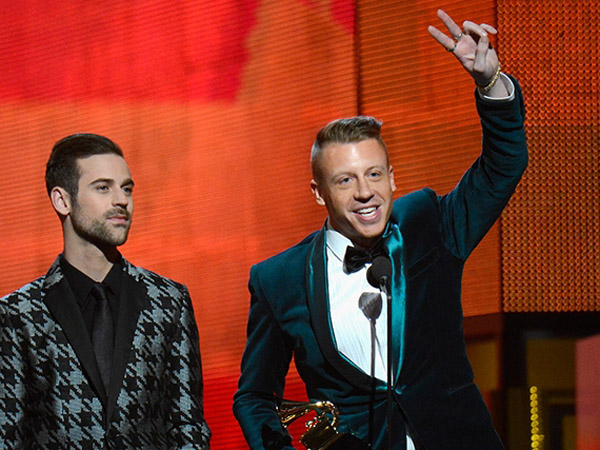 Ryan Lewis (left) and Macklemore at the 56th annual Grammy Awards.