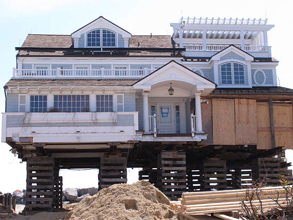 A house on the Mantoloking beachfront is being elevated to protect against future storms. Some people have settled their claims and aid and are rebuilding, while others are still looking for checks. WAYNE PARRY / Associated Press