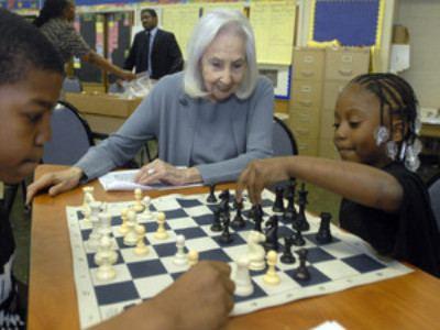 Marciene Mattleman watches India Squire make a move against Jarell Irving at Gideon Elementary. Mattleman´s ASAP program helped the city school form a chess club.
