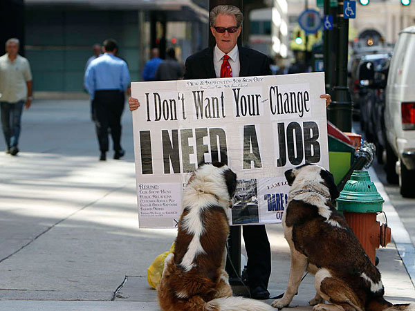 "Mark Mercer and his two dogs, Stanley and Oliver, stand along Market Street in Philadelphia on Aug. 14, 2013. He has been out of work since 2011 and has applied for work the old-fashion way to no avail. This summer he began standing in the city´s financial district with a sign that reads,""I don´t want your change. I need a job."" (David Maialetti / Staff Photographer)"