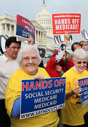 A rally on Capitol Hill in Washington in October 2011 against potential cuts in programs including Medicare.  (J. Scott Applewhite / AP Photo)<br />