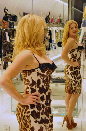 Megan Hilty tries on a dress at Just Cavalli at the Water Club
