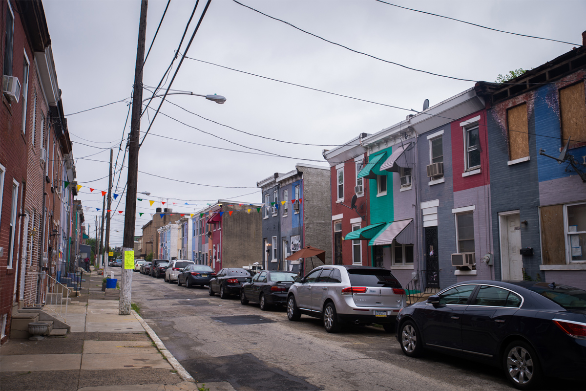 The 3800 block of Melon street in Mantua. Once a blighted block, the area has started to turn around - in part, thanks to the Philadelphia Mural Arts program.