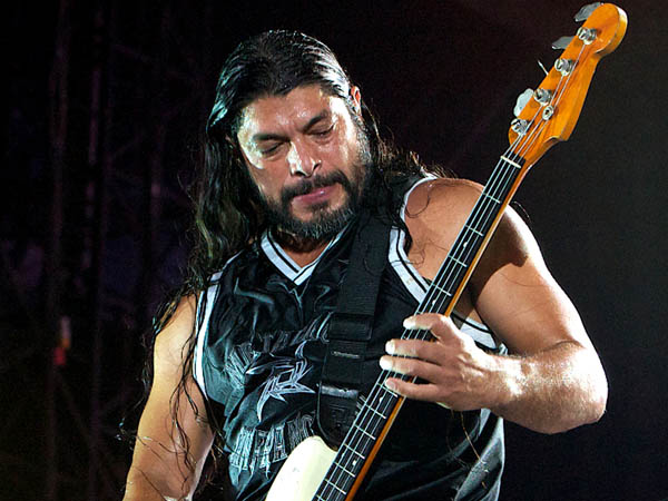 "This Oct. 25, 2011 file photo shows Metallica´s bassist Robert Trujillo performing on Yas Island, Abu Dhabi, United Arab Emirates. The film, ""Metallica Through The Never"" opens exclusively in Imax 3D on Sept 27, and nationwide on Oct 4.(AP Photo/Nousha Salimi, File)"