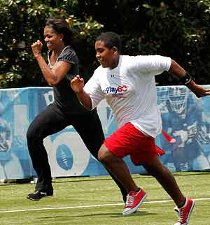 First lady Michelle Obama ran a 40-yard sprint to promote her Let's Move! anti-obesity campaign. (Gerald Herbert / AP)<br />