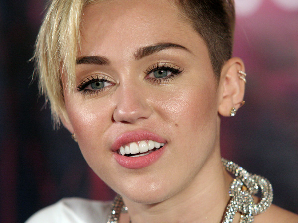 Recording artist Miley Cyrus attends an album release signing event, on Tuesday, Oct. 8, 2013, at Planet Hollywood in New York. (Photo by Andy Kropa/Invision/AP)