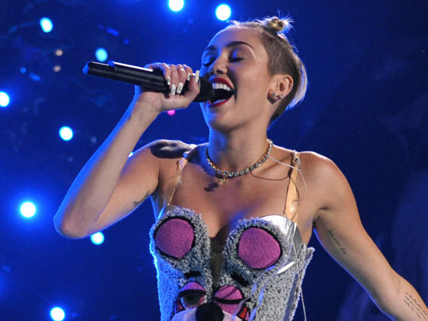 Miley Cyrus performs at the MTV Video Music Awards at Barclays Center on Sunday, Aug. 25, 2013, in Brooklyn. (AP Photo/MTV, John Shearer)