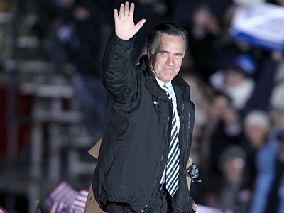 Gov. Mitt Romney waves to the crowd as he arrives at Shady Brook Farm in Yardley, PA. for a campaign rally. Thousands braved the cold for hours just 2 days before the Presidential election. (Charles Fox / Staff Photographer)
