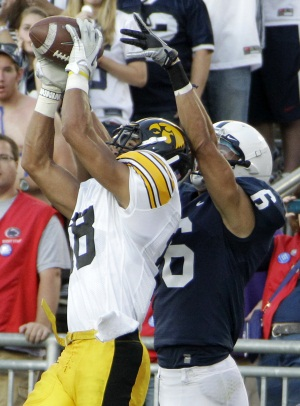 Penn State wide receiver Derek Moye (right) jumps for pass as Iowa&acute;s John Chelf gets there first for the interception last Saturday. <br /> (AP Photo/Gene Puskar)