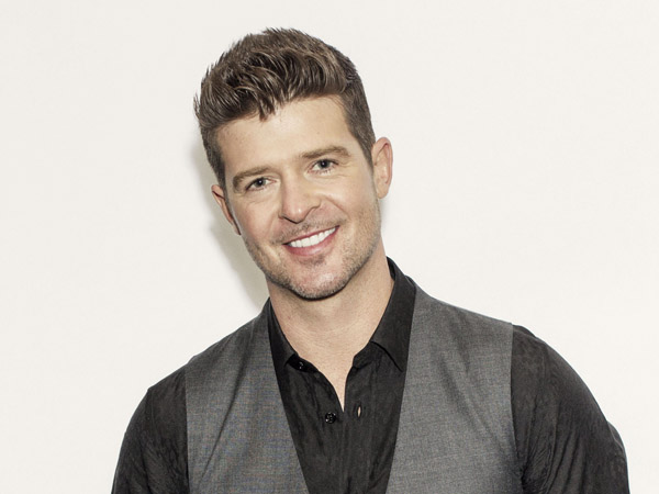 "Thicke released his fifth album, ""Blurred Lines,"" on Aug. 2. The title track and lead single, which features T.I. and Pharrell, is the longest-running No. 1 song on the Billboard Hot 100 chart so far this year. (Photo by Victoria Will/Invision/AP)"