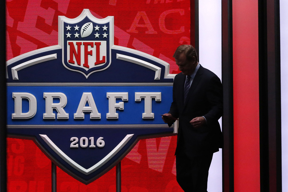 NFL Commissioner Roger Goodell stands on the stage of the 2016 NFL Draft in Chicago. This year, the draft is taking place in Philadelphia for the first time since 1960.