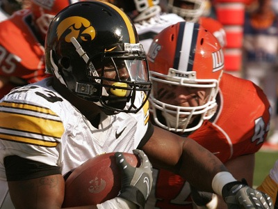 Iowa´s Shonn Greene, left, runs through Illinois´ Brit Miller (44) during the first half of the NCAA college football game at the University of Illinois in Champaign, Ill., Saturday, Nov. 1, 2008. Illinois defeated Iowa 27-24. (AP Photo/Seth Perlman)
