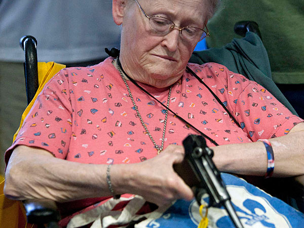 At the NRA convention in Houston in May 2013, Janet Bero waits to have her German Luger appraised.  JOHNNY HANSON / Houston Chronicle