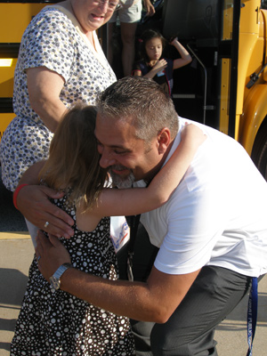 It was hugs and smiles for Dorothy L. Bullock School Principal Joseph DePalma as first through third grade students arrived on busses for their first day.