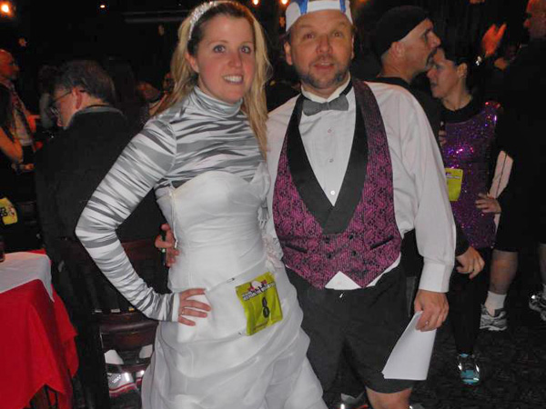 Here comes the bride! Polly Bogucki, shown here with race director Pat McCloskey, ran the 2010 Philadelphia New Year´s Eve 5K in her wedding dress.