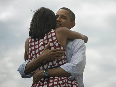 "President Barack Obama and First Lady Michelle Obama embrace in a photo that has become the most retweeted ever after Obama campaign staffers released it with the words, ""Four more years"" on election night."