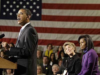 President-elect Barack Obama, accompanied by his wife Michelle Obama, right, and Patricia Stiles, of Parker, Colo., center, speaks at 30th Street Station today before his whistle stop train trip. (AP Photo/Alex Brandon)<br /><br />