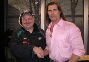 Steve Odabashian, as Andy Reid, shakes hands with Fabio.