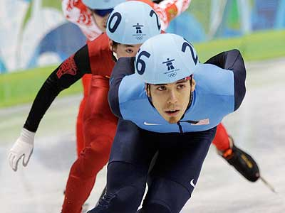 USA´s Apolo Anton Ohno leading the pack during a preliminary heat of the 1,000-meter short track competition at the 2010 Vancouver Games. Comcast´s NBC Universal won the right to continue broadcasting the Games in the U.S. (Mark Baker / Associated Press)